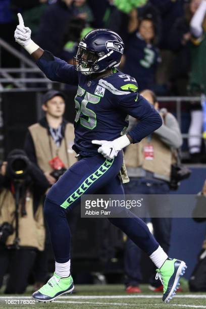 Frank Clark of the Seattle Seahawks celebrates a defensive stop in the first half against the Green Bay Packers at CenturyLink Field on November 15...