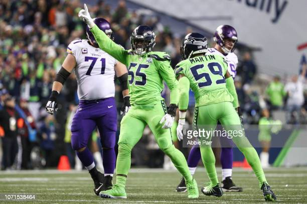 Frank Clark of the Seattle Seahawks celebrates a second quarter defensive stop against the Minnesota Vikings at CenturyLink Field on December 10 2018...