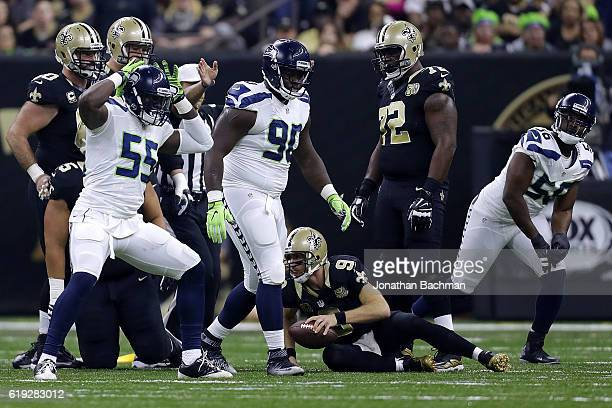 Frank Clark of the Seattle Seahawks reacts after sacking Drew Brees of the New Orleans Saints during the first half of a game at the MercedesBenz...