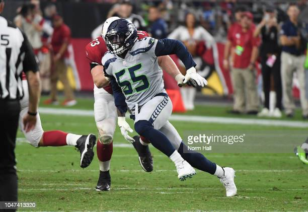Frank Clark of the Seattle Seahawks rushes around John Wetzel of the Arizona Cardinals at State Farm Stadium on September 30 2018 in Glendale Arizona