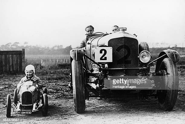 Frank Clement and Woolf Barnato in a Bentley Speed 6 Brooklands Surrey 1930 Beside a child in their toy car They were both known as Bentley Boys...