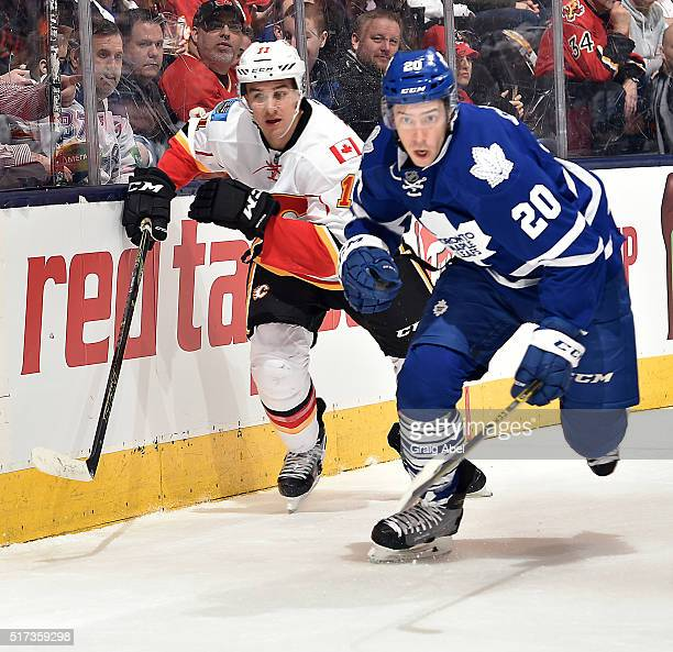 Frank Corrado of the Toronto Maple Leafs skates up ice with Mikael Backlund of the Calgary Flames during game action on March 21 2016 at Air Canada...