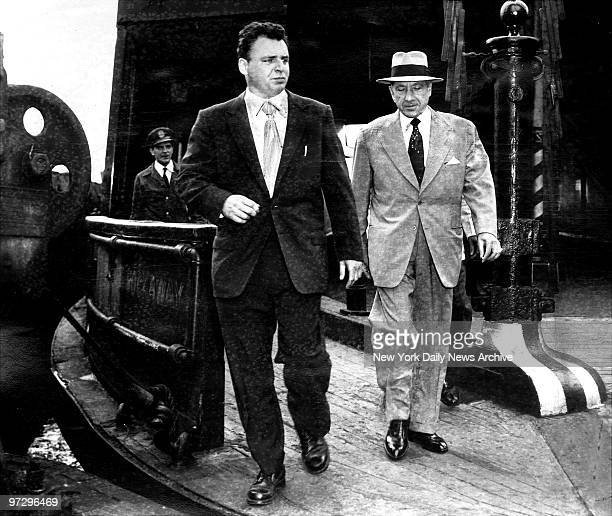 Frank Costello flanked by police detective is freed from Rikers Island