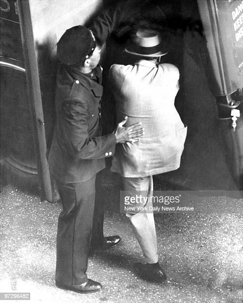 Frank Costello gets a boost into a prison van at City Prison for the ride to Rikers Island to serve a 30 day term for contempt