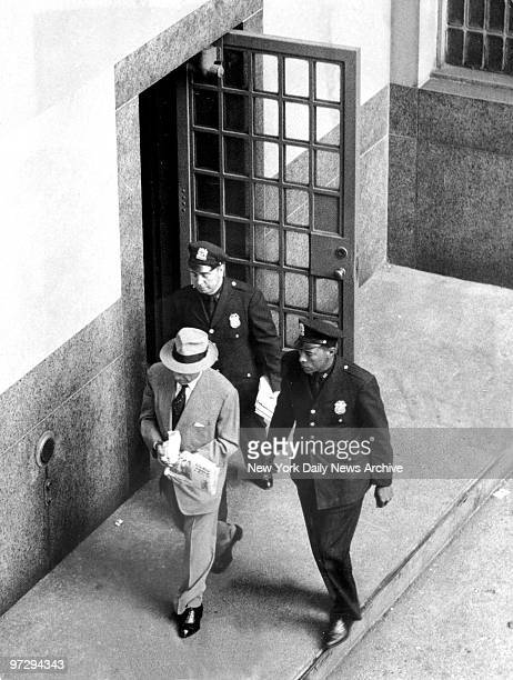 Frank Costello leaving the Tombs Prison with Deptartment of Corrections officers on way to Rikers Island to serve a 30day rap for contempt
