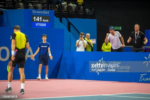 Frank Dancevic coach of Vasek Pospisil of Canada celebrates a vital break back in the third set during his match against David Goffin of Belgium in...