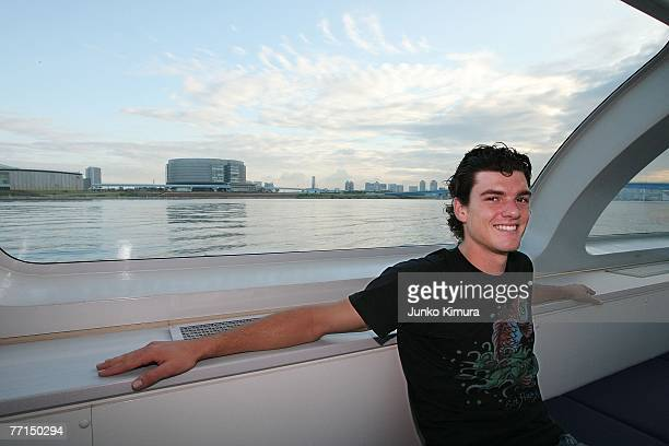 Frank Dancevic of Canada poses for photographs on a ferry at Tokyo Bay during day two of the AIG Japan Open Tennis Championships held at Ariake...