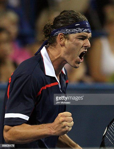 Frank Dancevic of Canada reacts after a point against Tommy Haas of Germany during Day 2 of the Legg Mason Tennis Classic at the William H.G....