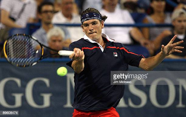 Frank Dancevic of Canada returns a shot against Tommy Haas of Germany during Day 2 of the Legg Mason Tennis Classic at the William H.G. FitzGerald...