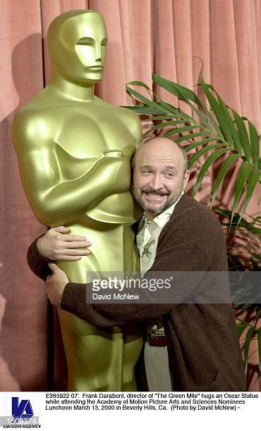 Frank Darabont screenwriterdirector of nominee The Green Mile hugs an Oscar Statue while attending the Academy of Motion Picture Arts and Sciences...