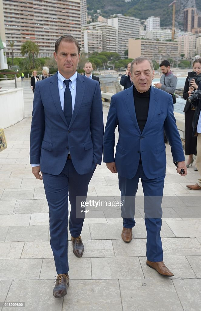 Frank de booer (Left) Dutch football manager of Inter Milan and Golden Foot President Antonio Caliendo visit The Champions Promenade along the sea front during the 2016 Golden Foot Awards day in Monaco on October 11, 2016. / AFP / Yann COATSALIOU
