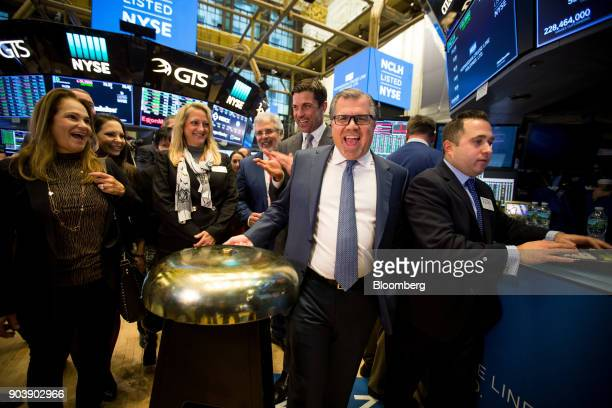 Frank Del Rio chief executive officer and president of Norwegian Cruise Line Holdings Ltd second right rings a ceremonial bell on the floor of the...