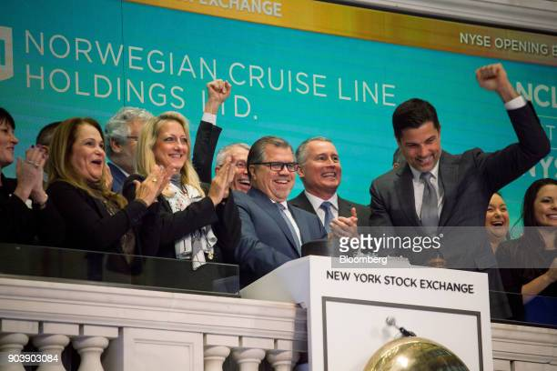Frank Del Rio chief executive officer and president of Norwegian Cruise Line Holdings Ltd center rings the opening bell on the floor of the New York...