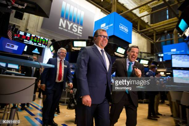 Frank Del Rio chief executive officer and president of Norwegian Cruise Line Holdings Ltd center and Chris Taylor vice president of listings and...