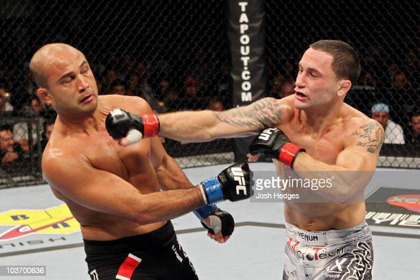 Frank Edgar connects with a punch to the face of BJ Penn during their UFC 118 lightweight title bout at the TD Garden on August 28, 2010 in Boston,...
