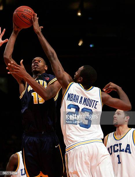 Frank Elegar of the Drexel Dragons puts up a shot over Luc Richard Mbah a Moute of the UCLA Bruins during their Preseason NIT Tournament game at...