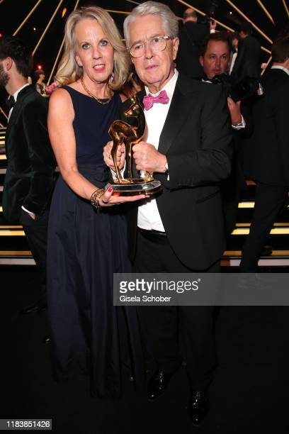 Frank Elstner and his wife Britta Gessler with award during the 71st Bambi Awards final applause at Festspielhaus Baden-Baden on November 21, 2019 in...