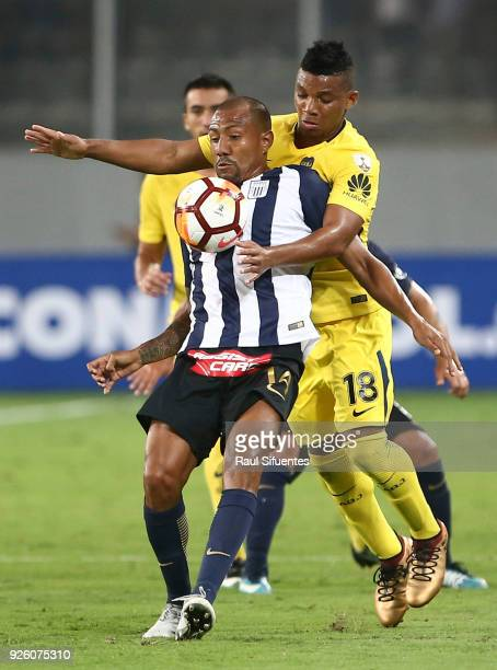 Frank Fabra Boca Juniors struggles for the ball with Luis Ramirez of Alianza Lima during a groups stage match between Alianza Lima and Boca Juniors...