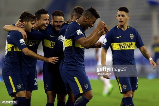 Frank Fabra of Boca Juniors celebrates with teammates after scoring his team's fourth goal during a match between Velez Sarsfield and Boca Juniors as...