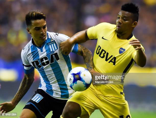 Frank Fabra of Boca Juniors fights for ball with Renzo Sarabia of Racing Club during a match between Boca Juniors and Racing Club as part of the...