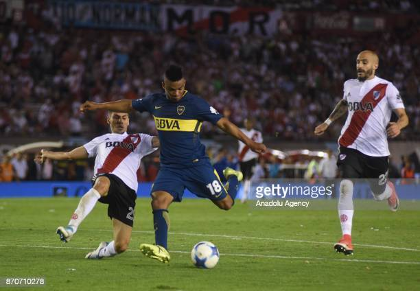 Frank Fabra of Boca Juniors fights for the ball with Gonzalo Montiel and Javier Pinola of River Plate during the match for the eighth date of the...