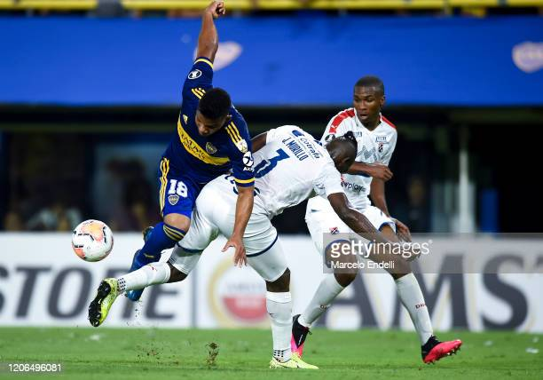 Frank Fabra of Boca Juniors fights for the ball with Jesus Murillo of Deportivo Independiente Medellin during a Group H match between Boca Juniors...