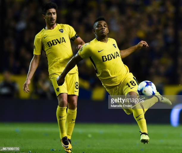 Frank Fabra of Boca Juniors runs for the ball next to his teammate Pablo Perez during a match between Boca Juniors and Belgrano as part of Superliga...