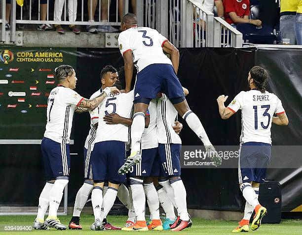 Frank Fabra of Colombia celebrates with his teammates after scoring a goal against Costa Rica in the first half in group A match between Colombia and...
