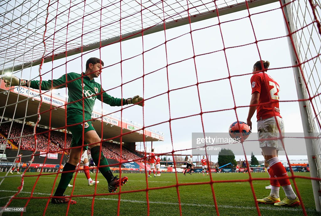 Frank Fielding, Goalkeeper of Bristol City (L) kicks the ball away in frustration after conceeding a goal during the FA Cup Fourth Round match between Bristol City and West Ham United at Ashton Gate on January 25, 2015 in Bristol, England.