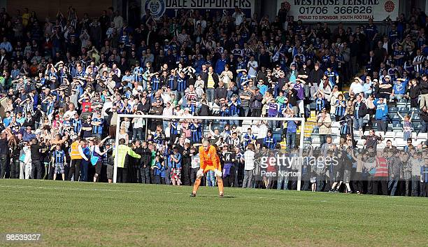 Frank Fielding of Rochdale looks on as fans wait on the touchline for the final whistle to celebrate Rochdale's first promotion in 41 years at the...