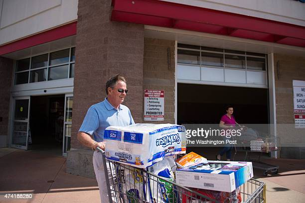 Frank Fiorina husband of Republican presidential candidate Carly Fiorina carries his items back to a car after shopping at a Costco in Woodbridge VA...