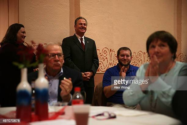 Frank Fiorina husband of Republican presidential candidate Carly Fiorina listens during the 2015 Lincoln Dinner of Adair County Republican Party...