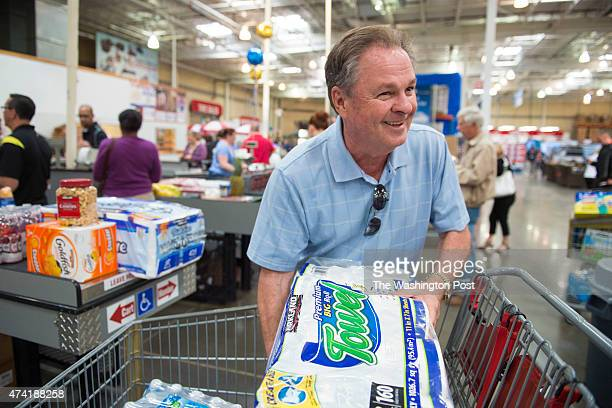 Frank Fiorina husband of Republican presidential candidate Carly Fiorina prepares to pay for his items while shopping at a Costco in Woodbridge VA on...