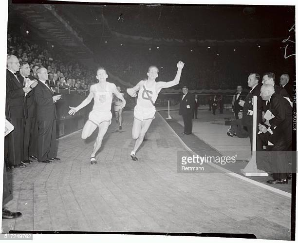 Frank Fox, unattached, is shown winning the 600-yard run at tonight's Millrose games at Madison Square Garden; with Charles Moore, of Cornell,...