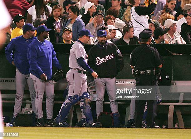 Frank Francisco of the Texas Rangers looks into the crowd from the bullpen against the Oakland Athletics during a MLB game at the Network Associates...