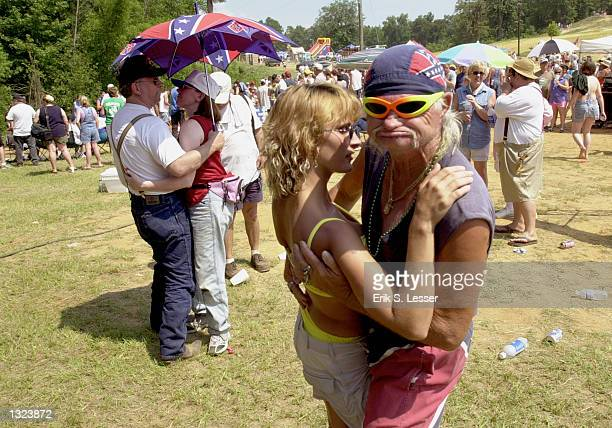 """Frank """"Freight Train"""" Mills, right, and Virginia Scarboro dance to country music during the 6th annual Summer Redneck Games July 7, 2001 in East..."""