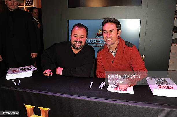Frank Fritz and Mike Wolfe from American Pickers sign autographs for fans during the grand opening of the History Pop Shop at History Pop Shop on...