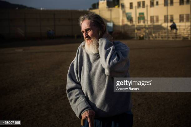 Frank Fuller age 66 stands alone in the prison yard during free time after breakfast at California Men's Colony prison on December 19 2013 in San...