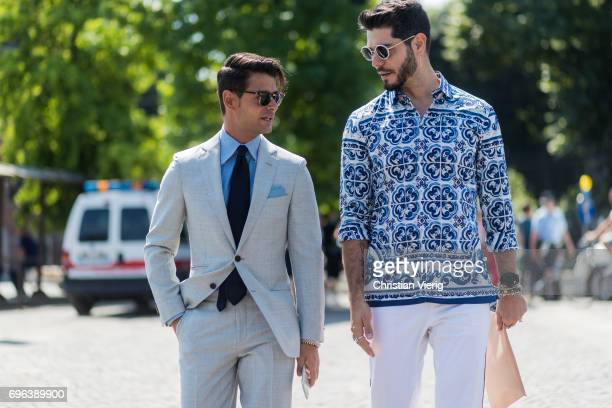 Frank Gallucci and Kadu Dantas wearing suit white pants shirt with print is seen during Pitti Immagine Uomo 92 at Fortezza Da Basso on June 15 2017...