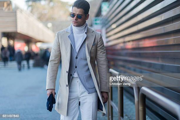 Frank Gallucci is wearing white pants beige coat cardigan on January 11 2017 in Florence Italy