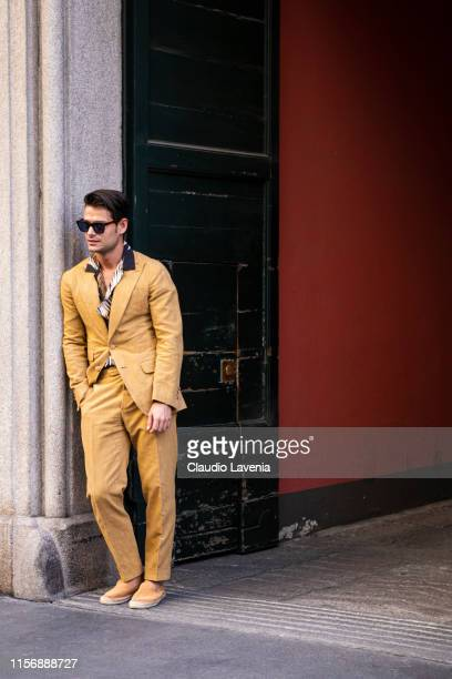 Frank Gallucci wearing a tan suit printed shirt and orange espadrilles is seen outside Giorgio Armani show during the Milan Men's Fashion Week...