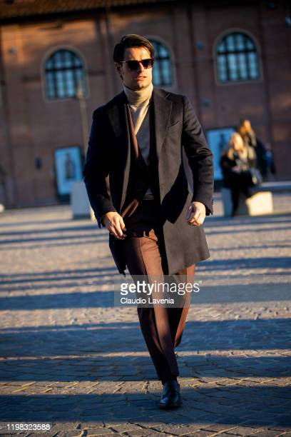 Frank Gallucci, wearing beige turtleneck sweater, brown suit and blue coat, is seen at Fortezza Da Basso on January 08, 2020 in Florence, Italy.