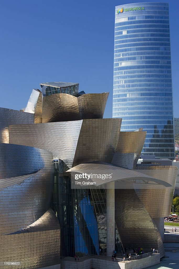 Frank Gehry's Guggenheim Museum futuristic architectural design in titanium  and glass and Iberdrola Tower at Bilbao