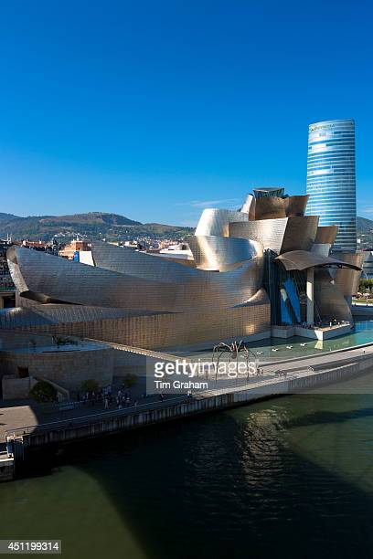 Frank Gehry's Guggenheim Museum The Spider sculpture Iberdrola Tower and River Nervion at Bilbao Spain