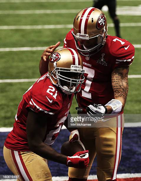 Frank Gore and Colin Kaepernick of the San Francisco 49ers celebrate after Gore scored a 6-yard rushing touchdown in the third quarter against the...