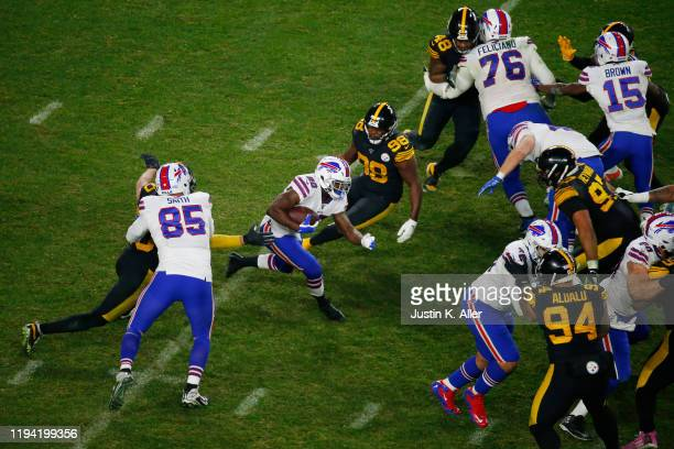 Frank Gore of the Buffalo Bills carries the ball during the second half against the Pittsburgh Steelers in the game at Heinz Field on December 15,...