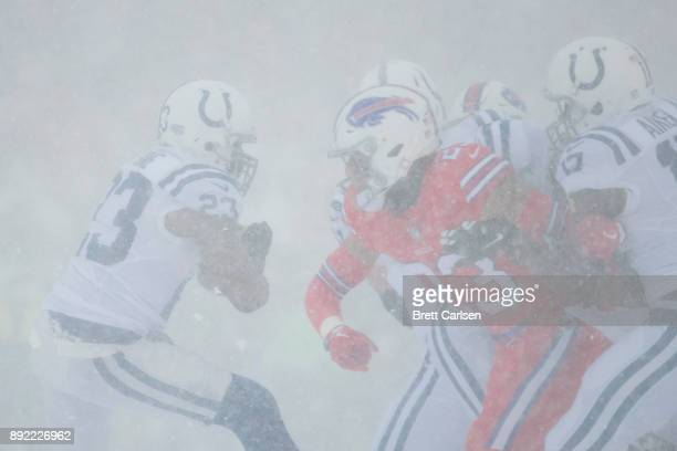 Frank Gore of the Indianapolis Colts carries the ball during the first quarter against the Buffalo Bills at New Era Field on December 10 2017 in...
