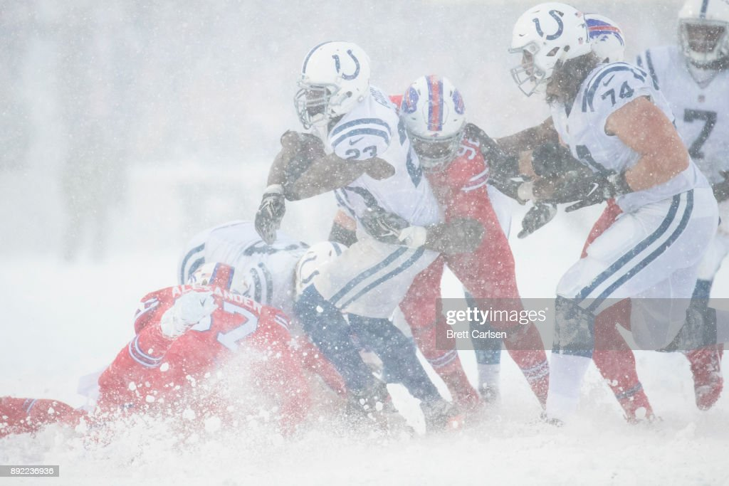 Frank Gore #23 of the Indianapolis Colts is brought down by Adolphus Washington #92 of the Buffalo Bills during the second half at New Era Field on December 10, 2017 in Orchard Park, New York. Buffalo defeats Indianapolis in overtime 13-7.