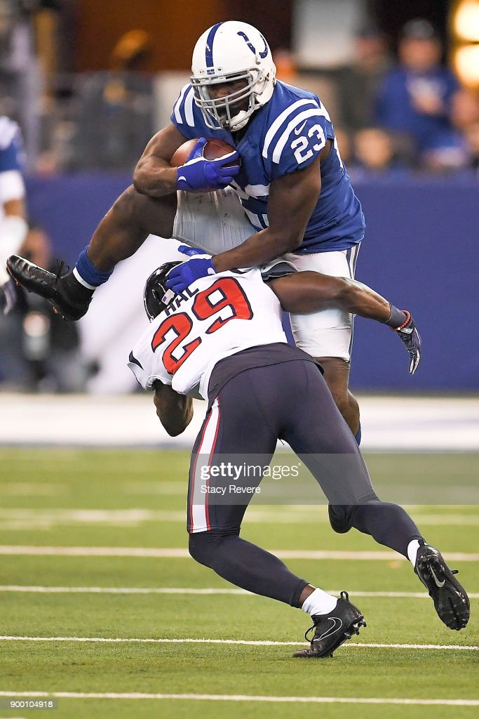 Frank Gore #23 of the Indianapolis Colts jumps over Andre Hal #29 of the Houston Texans during the second half at Lucas Oil Stadium on December 31, 2017 in Indianapolis, Indiana.