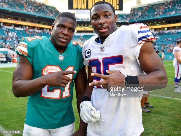 Frank Gore of the Miami Dolphins and LeSean McCoy of the Buffalo Bills after the game at Hard Rock Stadium on December 2, 2018 in Miami, Florida.